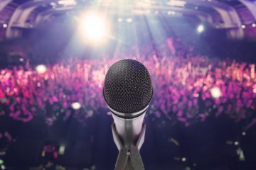 Microphone with an audience on the background